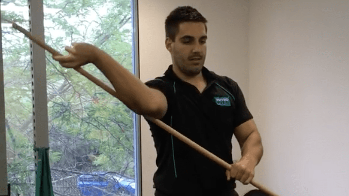 using a stick to loosen shoulder optimal shoulder health