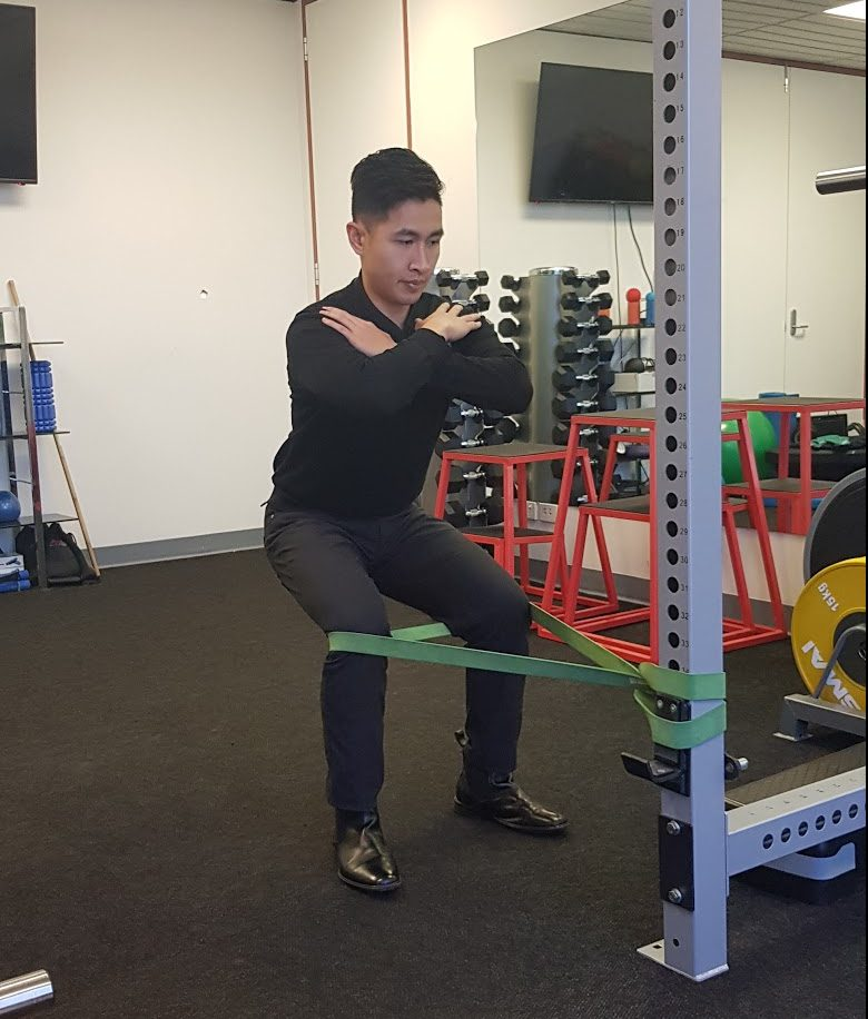 using stretch band for squats