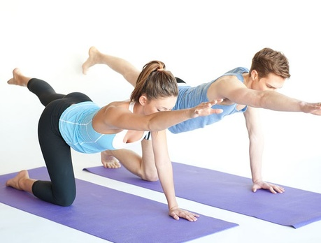 Pilates Man And Woman Performing Movement