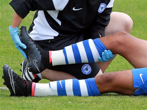 Sports Physio Working On Ankle Pain